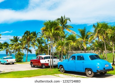 Varadero, Cuba - September 24, 2018: American Oldsmobile, Buick, and Chevrolet vintage cars parked in near the beach in Varadero Cuba - Serie Cuba Reportage