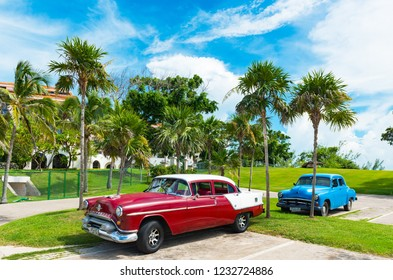 Varadero, Cuba - September 24, 2018: American Oldsmobile and a Buick vintage car parked in near the beach in Varadero Cuba - Serie Cuba Reportage