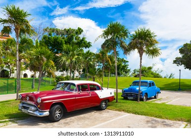Varadero, Cuba - September 24, 2018: American red brown 1954 Oldsmobile Super 88 vintage car with white roof  parked under blue sky near the beach in Havana Cuba - Serie Cuba Reportage