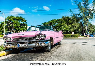 Varadero, Cuba - September 28, 2018: HDR - American pink Cadillac vintage car in the front view in Varadero Cuba - Serie Cuba Reportage