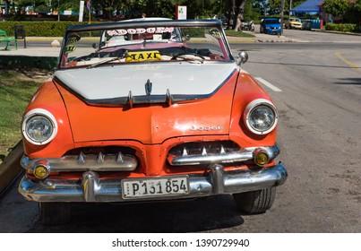 Varadero, Cuba - September 28, 2018: American orange 1955 Dodge Custom Royal convertible vintage car parked in the sidestreet from Varadero Cuba - Serie Cuba Reportage