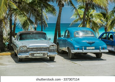 Varadero island, Cuba, Nov.8, 2014, amazing gorgeous view of classic retro vintage cars parked in tropical garden against tranquil ocean and blue sky background