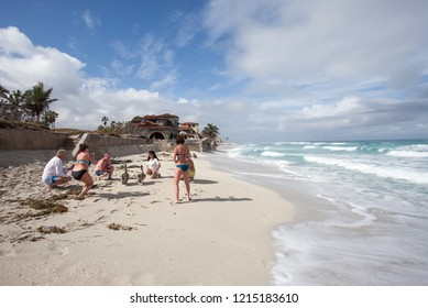 """""""Varadero, Matanzas / Cuba - January 25 2018: Tourists taking pictures of the pelicans and each other in front of Al Capone's house on the beach"""""""
