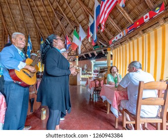 Varadero, Matanzas, Cuba- September 9, 2018: Cuban traditional acoustic music group playing for tourists in restaurant 'El Rancho' which is a major tourist attraction in First Avenue