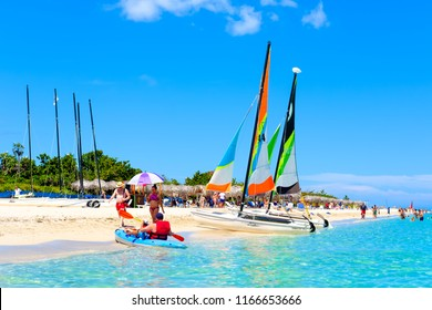 VARADERO,CUBA - AUGUST 23,2018 : The famous Varadero beach in Cuba in a beautiful summer day with people and colorful sailboats