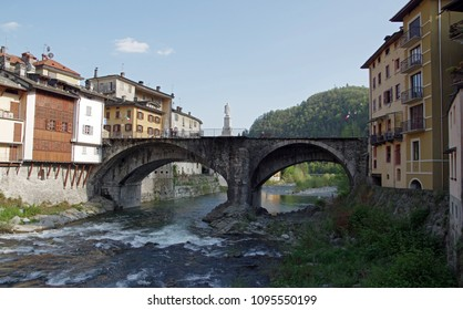 VARALLO SESIA, ITALY - 25 APRIL 2018: a view of houses and the bridge over the river Sesia in the village Varallo Sesia, Piedmont, Italy.