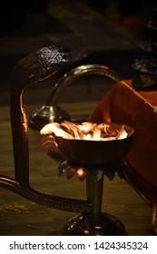 Varanasi (Banaras) Ganga aarti ceremony rituals performed by Hindu priests in evening at Dashashwamedh Ghat in Varanasi Uttar Pradesh India. Closeup of beautiful fire candles for Ganga ceremony