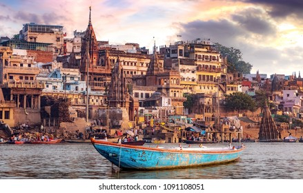 Varanasi city with ancient architecture. View of the holy Manikarnika ghat at Varanasi India at sunset.