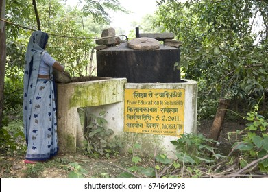 Varanasi / India 20 September 2011 Woman with the household biogas plantat  at village in Varanasi Uttar Pradesh India