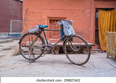 VARANASI, INDIA - 21 FEBRUARY 2015: Newspaperman's bicycle in street with fresh newspapers.