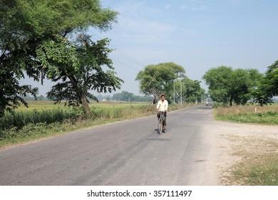 Varanasi ,India . 21- October -2015.The man riding his bicycle.