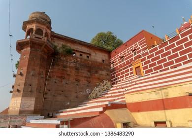 Varanasi / India 23 April 2019 The Varanasi Heritage Dossier Chet Singh Ghat and Palace Fort on banks of The Ganges River in holy city of Varanasi Northern India,Uttar Pradesh