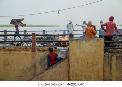 VARANASI, INDIA- 23 JULY 2016 : Unidentified people attend the religious funeral ceremony of a dead person at the banks of Ganges, Burning Ghats and the cremation grounds on the bank of river Ganges.