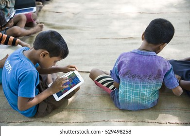 Varanasi / India 24 June  2015 ,indian rural village students studying on tablet at Varanasi Uttar pradesh India