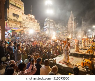 VARANASI, INDIA - 24 Oct 2016: Crowds watch as priests perform the Ganga Aarti ceremony at Dasaswamedh Ghat on October 24, 2016 in Varanasi, India