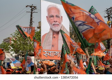 Varanasi / India 25 April 2019 BJP party workers and supporters waved the Lotus print flags during  Prime Minister Narendra Modi road show in Varanasi northern Indian state of Uttar Pradesh
