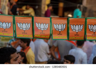 Varanasi / India 25 April 2019 BJP party Paper flags hanging in row during modi road show in Varanasi northern Indian state of Uttar Pradesh