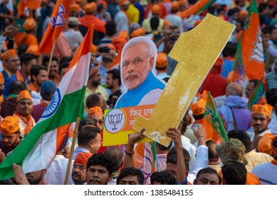 Varanasi / India 25 April 2019 BJP party workers and supporters waved the  lotus flag and held placards with pictures of Prime Minister Narendra Modi during roadshow in Varanasi Uttar Pradesh