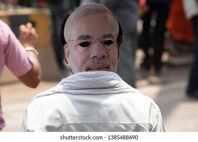 Varanasi / India 25 April 2019 BJP supporter wearing Modi masks during a road show in Varanasi northern Indian state of Uttar Pradesh