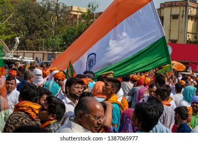 Varanasi / India 25 April 2019 Bharatiya Janata Party (BJP) supporters wave Indian national flag during lok sabha electionsin Varanasi Uttar Pradesh