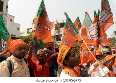 Varanasi / India 25 April 2019 BJP supporters waive party flags during  Modi roadshow before the filing of his nomination papers for the Lok Sabha polls in Varanasi Uttar Pradesh