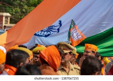 Varanasi / India 25 April 2019 Bharatiya Janata Party (BJP) supporters wave Indian national flag during lok sabha elections in Varanasi Uttar Pradesh