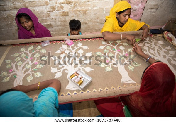 ba03895234 Varanasi / India 26 March 2018 Young girls doing hand embroidery work in  her home at