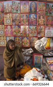 Varanasi / India 27 January2008 Woman selling Coloruful Posters Of Hindu Gods And Goddesses at Varanasi Uttar Pradesh  , India