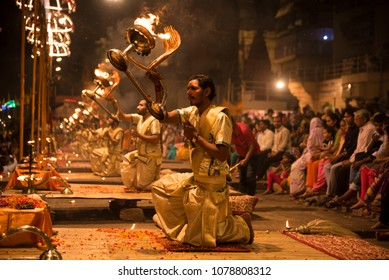 Varanasi / India 27 March 2018 Ganga aarti ceremony rituals performed by Hindu priests at Dashashwamedh Ghat in Varanasi Uttar Pradesh India