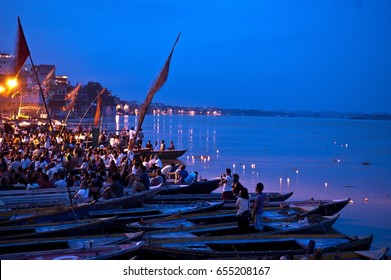Varanasi, India- 30 Jule 2011: Hindu people watching religious Ganga Aarti ritual (fire puja) from the water