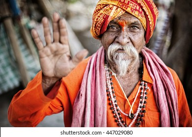 VARANASI INDIA 8 FEB 2013 :sadhu pose Namaste  for photo near Ghat of Ganga river  varanasi india