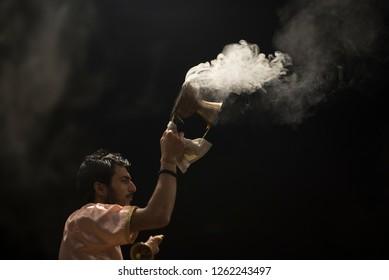 Varanasi / India 9 December 2018 Ganga Aarti puja ceremony performed in the evening by a priests with dhoop incense smokeat Dashashwamedh Ghat in Varanasi Uttar Pradesh India
