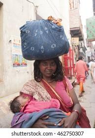 VARANASI, INDIA- 9 MAR 2013: Portrait of unidentified Hindu Woman pilgrims on ghats of  Holy river Ganges on the auspicious Maha Shivaratri festival.