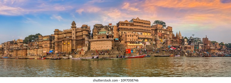 Varanasi India ancient city architecture panoramic view at sunset as seen from a boat on river Ganges.
