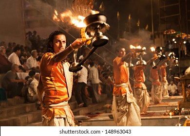 VARANASI, INDIA - APRIL 11: An unidentified Hindu priest performs religious Ganga Aarti ritual (fire puja) at Dashashwamedh Ghat on April 11, 2012 in Varanasi, Uttar Pradesh, India