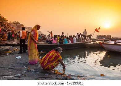 VARANASI, INDIA - APRIL 18: Crowd of local Indian live their morning life with Ganga river on April 18, 2010 in Varanasi, India. The most holy river of India and Hindu culture.