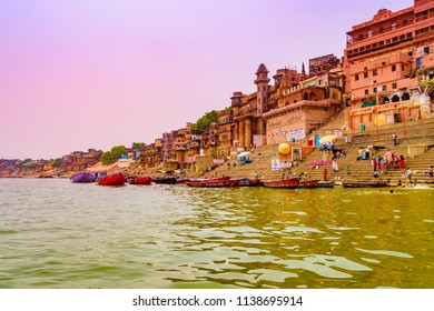 Varanasi, India - April-2018: Ganges river ghat with ancient architectural buildings and temples as viewed from a boat on the river at Varanasi , Uttar pradesh.