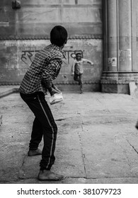 Varanasi, India - Circa January 2016 - Children playing cricket on the streets