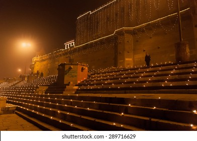 VARANASI, INDIA - DEC 23, 2014: Raja Ghat at night. Varanasi. Uttar Pradesh. Varanasi  is the holiest of the seven sacred cities in Hinduism and Jainism.