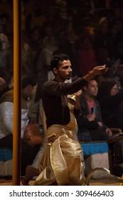 VARANASI, INDIA - DEC 23, 2014: Unidentified Indian priest performs religious Ganga Aarti ceremony or fire puja at Dashashwamedh Ghat in Varanasi. Uttar Pradesh