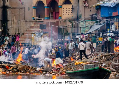 VARANASI, INDIA - February 11, 2015: The cremation of bodies at the holiest Manikarnika Ghat on the banks of the Ganges river in Varanasi, India.