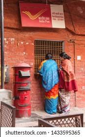 VARANASI, INDIA - FEBRUARY 11, 2015: Two Indian women a at India Post office in Varanasi, India.