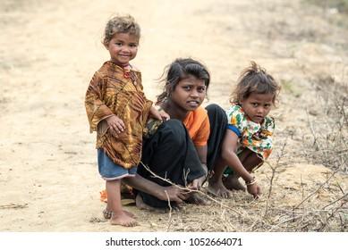 VARANASI, INDIA - FEBRUARY 12, 2018 : Portrait homeless children on the street near Ganges river in Varanasi, India .