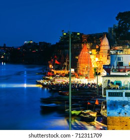 Varanasi, India. Ganges river aerial view in Varanasi, India. Ghats with boats and people. Popular landmark in the city at night