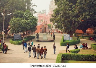 VARANASI, INDIA - JAN 3: Students go to campus through the park of Bannares Hindu University on January 3, 2013. The University is one of largest residential universities in Asia with 20,000 students