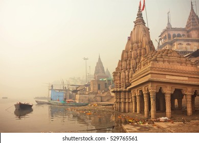 VARANASI, INDIA - JAN 4: Early morning at Ganges river near the flooded ancient architecture Shiva temple on January 4, 2016. Varanasi urban agglomeration had population of 1,435,113