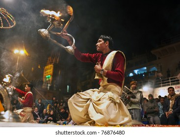 VARANASI, INDIA - JANUARY 14: An unidentified Hindu priests perform religious Ganga Aarti ritual (fire puja) at Dashashwamedh Ghat on January 14, 2010 in Varanasi, Uttar Pradesh, Central India