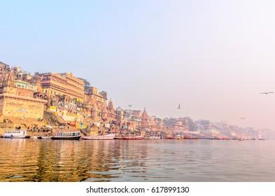 VARANASI, INDIA- January 18, 2017: Morning view of the ghats of sacred Ganges river in Varanasi, Uttar Pradesh, India.