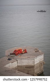 Varanasi, India, January 2009. A sadhu sleeping in a Ghat of the Ganges River.