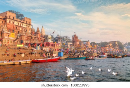 Varanasi, India, January 21,2019: Varanasi Ganges river ghat with ancient city architecture with view of migratory birds on river Ganga at sunset.